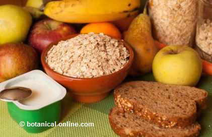 Photo: composition with oats with yogurt, whole wheat bread and fruit