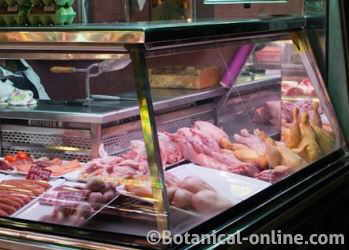 Photo of butcher shop in a market