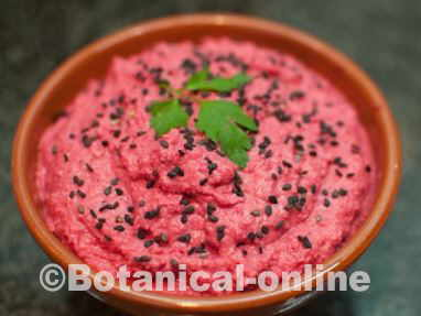 beet hummus decorated with black sesame