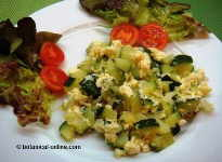 Scrambled eggs with zucchini and onions