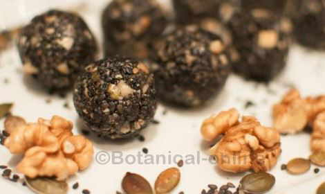 Truffles with black sesame, walnuts, pumpkin seeds and honey