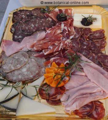 Embutidos, leche entera y queso curado, alimentos ricos en grasas saturadas